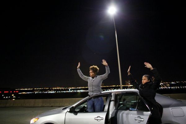 NEW YORK - DECEMBER 3: Protesters raise their hands to police on the West Side Highway December 3, 2014 in New York. Protests