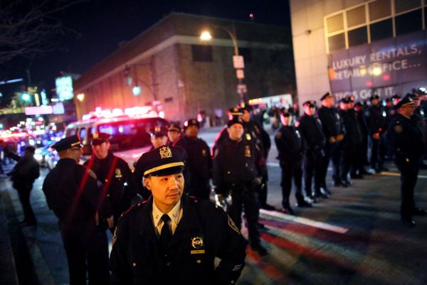 NEW YORK - DECEMBER 3: Police watch protesters stand together on the West Side Highway December 3, 2014 in New York. Protests