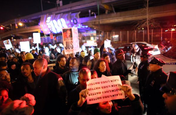 NEW YORK - DECEMBER 3: Police escort protesters off the West Side Highway December 3, 2014 in New York. Protests began after