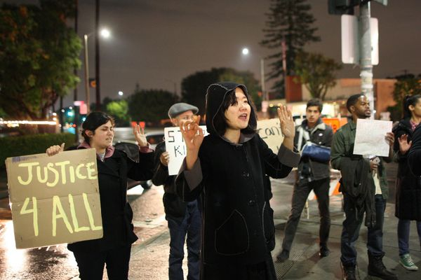 LOS ANGELES, CA - DECEMBER 3:  Protesters march in response to the decision by a New York grand jury not to indict a police o