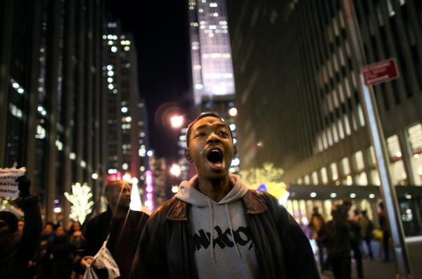 NEW YORK - DECEMBER 3: Demonstrators walk together during a protest December 3, 2014 in New York. Protests began after a Gran