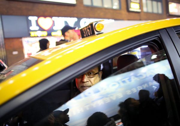 NEW YORK - DECEMBER 3: A cab driver watches protesters December 3, 2014 in New York. Protests began after a Grand Jury decide