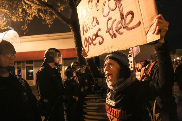 OAKLAND, CA - DECEMBER 3:  Maya Malika of Oakland confronts a line of police officers during a demonstration following a Stat