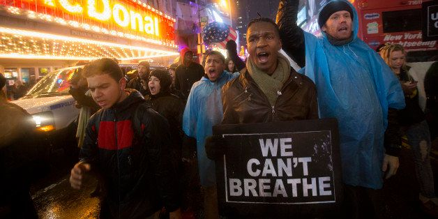 Protesters march against a grand jury's decision not to indict the police officer involved in the death of Eric Garner, Frida