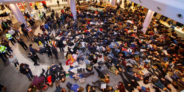 LONDON, UNITED KINGDOM - DECEMBER 10:  Protesters stage a 'die-in' as they demonstrate at White City Westfield Shopping Centr