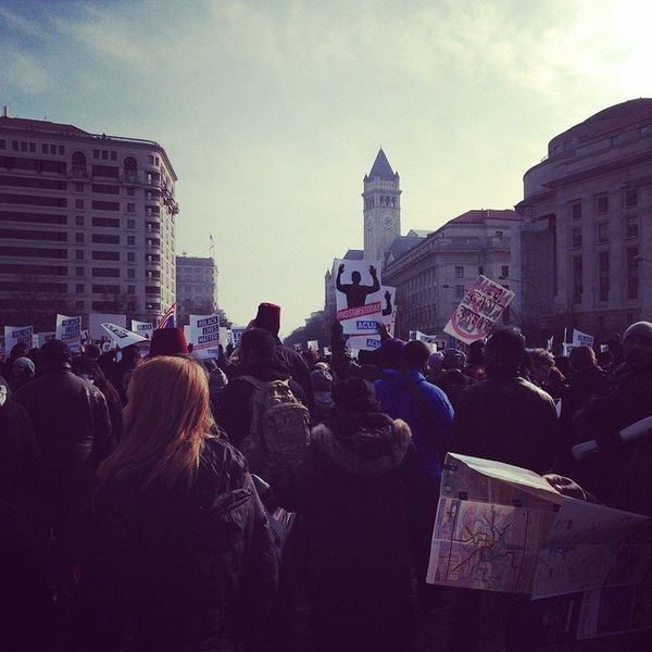 Protesters gather in Freedom Plaza for a march to the capitol in Washington, DC on Saturday, Dec. 13, 2014.