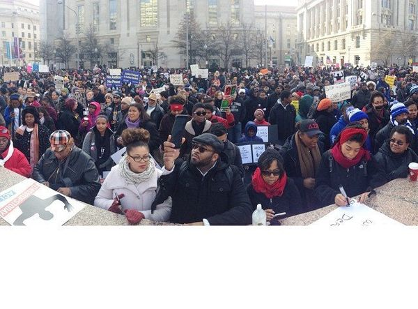 Protesters gather in Freedom Plaza before a march to the U.S. Capitol building in Washington, DC on Saturday, Dec. 13, 2014.