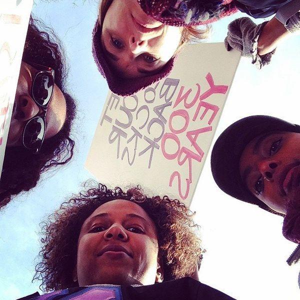 Protestors pose for a photo in Freedom Plaza in Washington, DC on Saturday, Dec. 13, 2014.