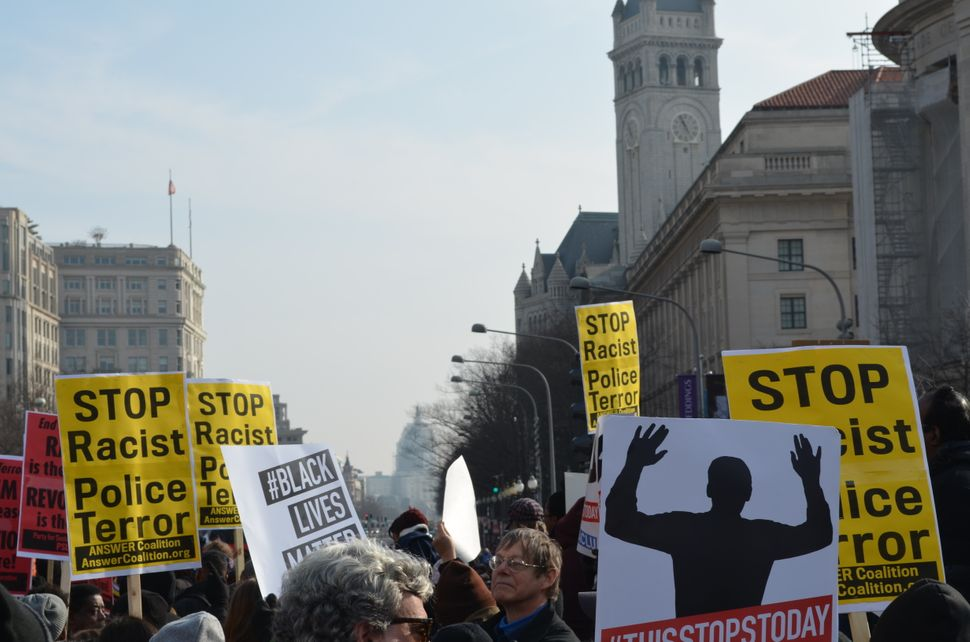 Protesters march towards the U.S. Capitol in Washington, DC on Saturday Dec. 13, 2014