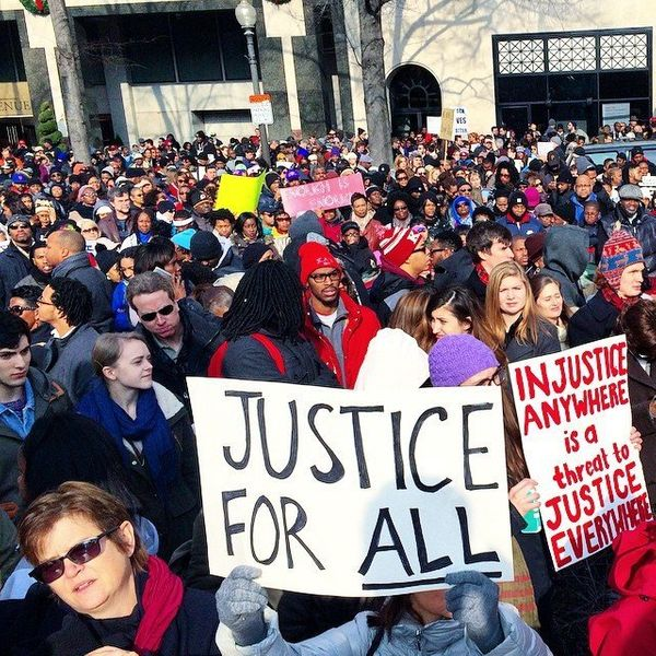 Protestors gather in Freedom Plaza in Washington, DC on Saturday, Dec. 13, 2014