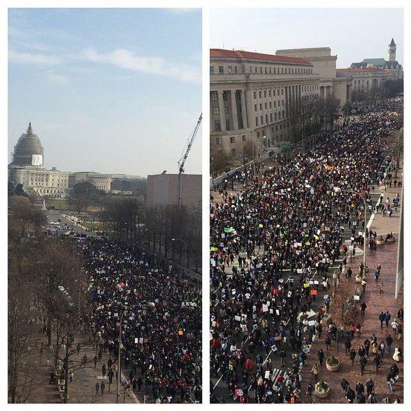 Protestors march down Pennsylvania Ave. in Washington, DC on Saturday, Dec. 13, 2014.