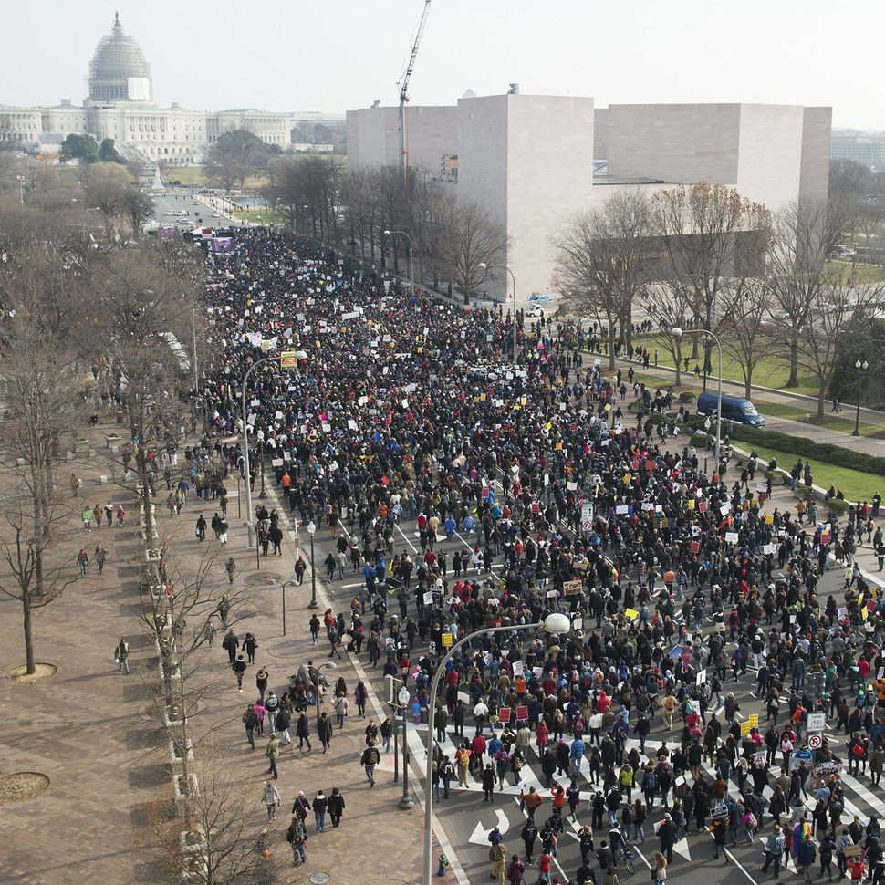 Thousands take part in the Justice for All March and Rally on Pennsylvania Avenue through downtown Washington, DC, December 1