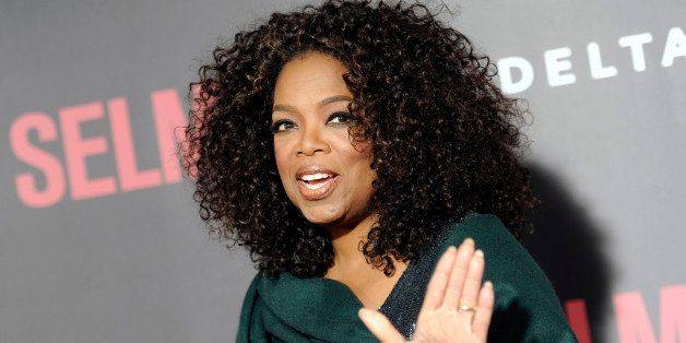 """Producer Oprah Winfrey attends the premiere of """"Selma"""" at the Ziegfeld Theatre on Sunday, Dec. 14, 2014, in New York. (Photo"""