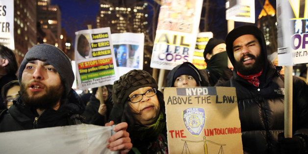 NEW YORK, NY - DECEMBER 19:  People demsonstate outside of City Hall against police violence at a rally that was supposed to