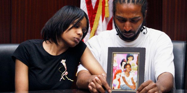 FILE -- In this May 18, 2010 file photo, Dominika Stanley and Charles Jones hold a photo of their 7-year-old daughter Aiyana