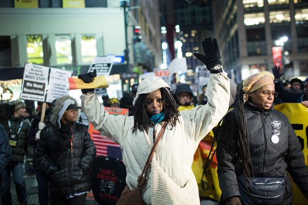 An activist holds her hands up during a protest march against police brutality that traveled from Union Square to Times Squar