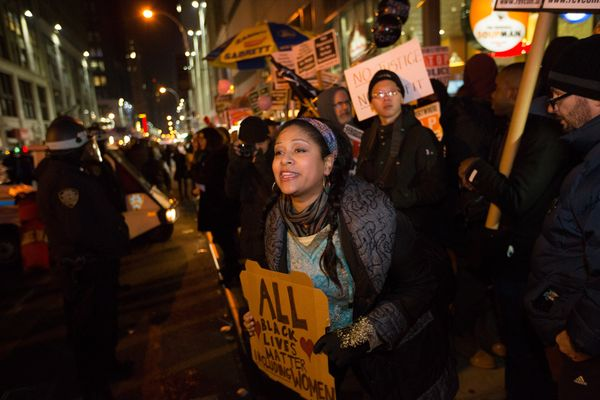 Activists confront police during a protest march against police brutality that traveled from Union Square to Times Square on