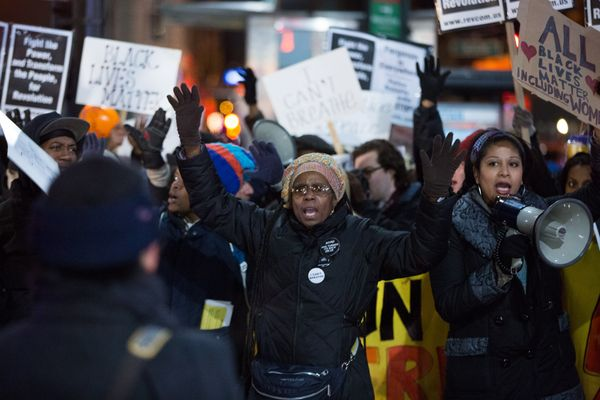 Activists take part in a protest march against police brutality that traveled from Union Square to Times Square on December 3