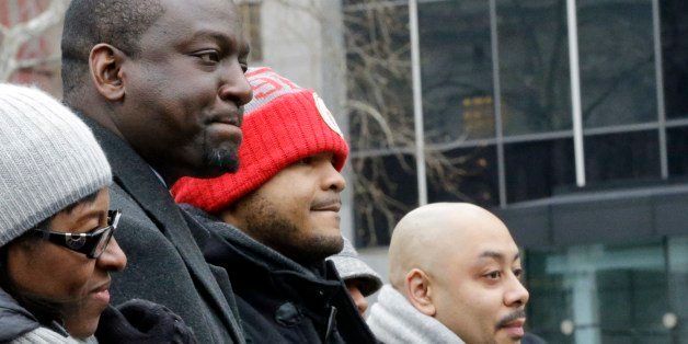Raymond Santana, right, Kevin Richardson, and Yusef Salaam, left, attend a rally at Foley Square Thursday, Jan. 17, 2013, in