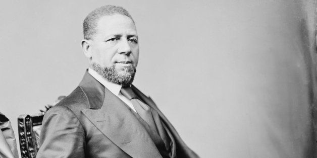 "<a href=""http://en.wikipedia.org/wiki/Hiram_Rhodes_Revels"" rel=""nofollow"">Hiram Rhodes Revels</a>, the first African-American"