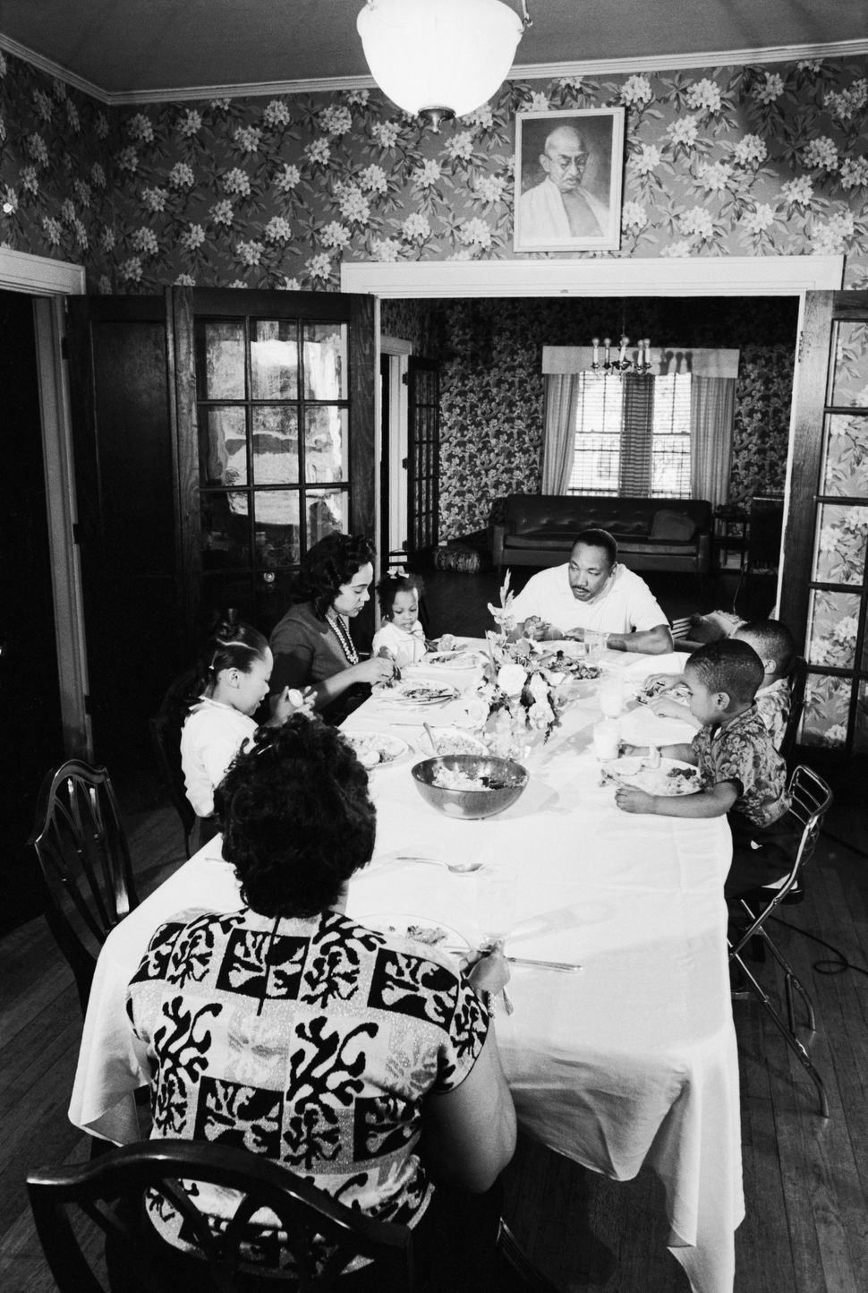 Martin Luther King Jr. and his family eat their Sunday dinner after church on November 8, 1964.