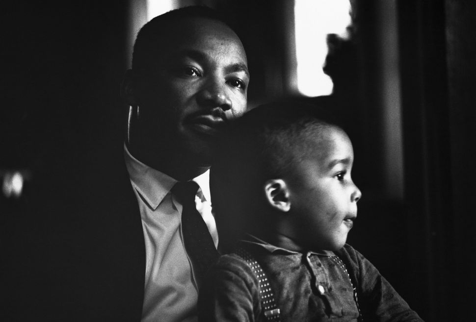 Martin Luther King Jr. holds his young son Dexter on his lap at home in Atlanta, November 8, 1960.