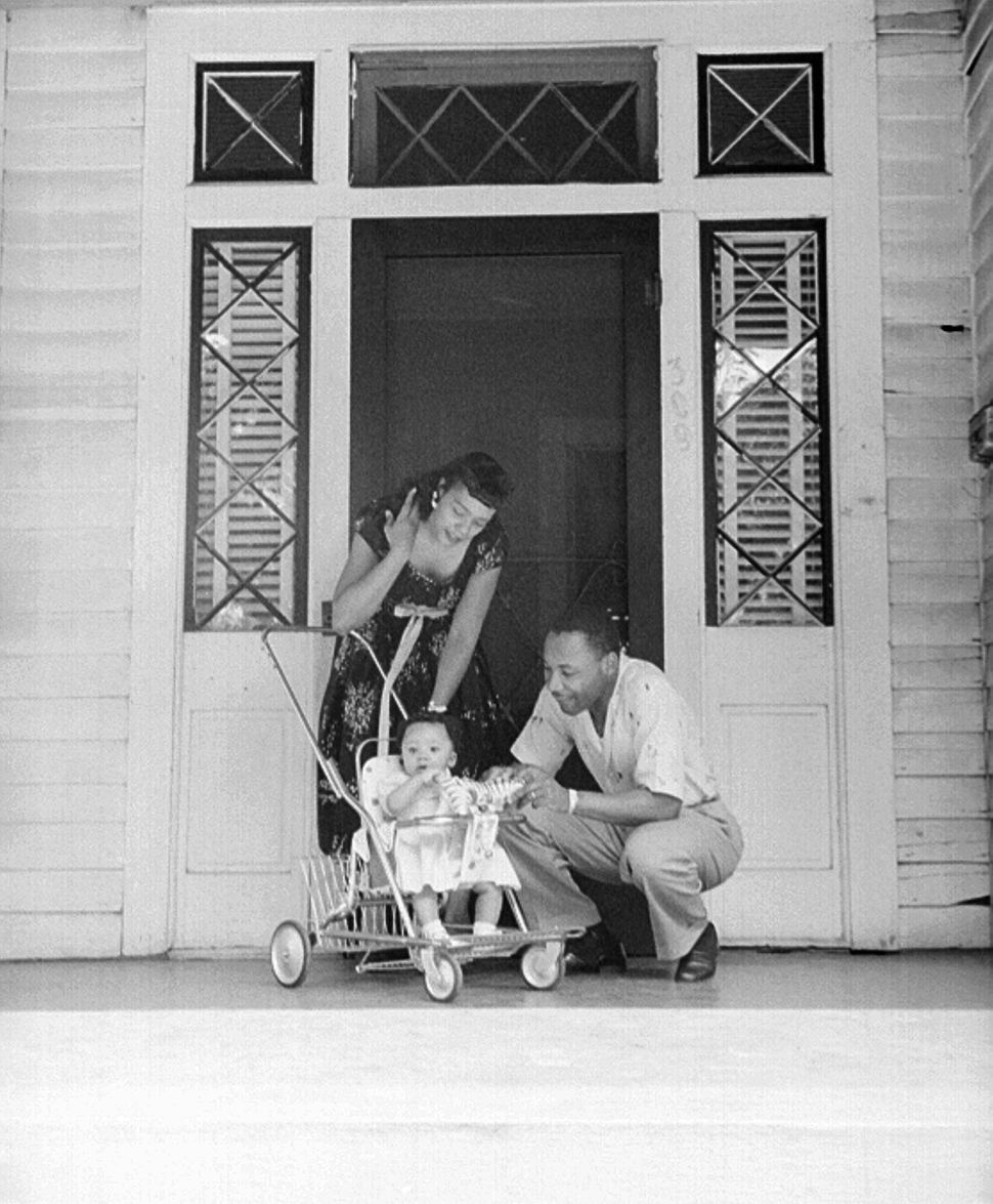Civil rights leader Reverend Martin Luther King, Jr. relaxes at home with his family in May 1956 in Montgomery, Alabama.