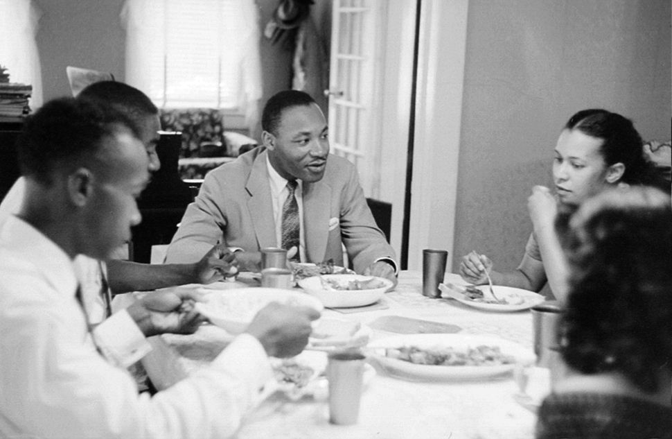 Civil rights leader Reverend Martin Luther King, Jr. relaxes at home with his family in May 1956 in Montgomery, Alabama. (