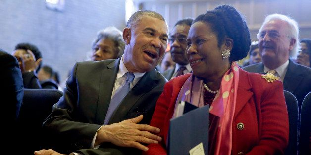 U.S. Rep. William Lacy Clay, D-Mo., left, talks with fellow Congressional Black Caucus member Rep. Shelia Jackson-Lee, D-Texa