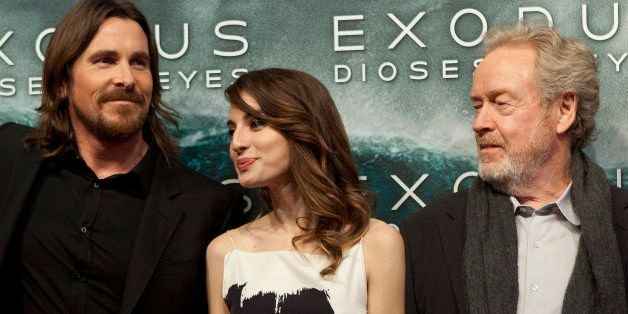 Christian Bale, Maria Valverde and Ridley Scott pose for photographers during the premiere of the film 'Exodus' in Madrid, on