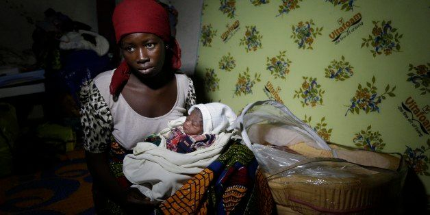 Maria Mala, a displaced woman with her new born baby Namadi, who was born Thursday morning rest at the camp for internally di