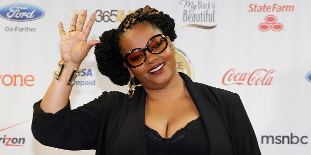 Singer Jill Scott poses for a photo in the pressroom at the Essence Festival at the Superdome on Friday, July 5, 2013, in New