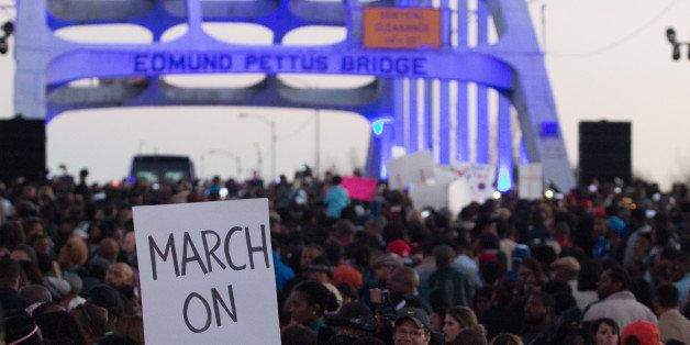 SELMA, AL - JANUARY 18:  A view of marchers as they assemble on the Edmund Pettus Bridge to commemorate the life of Dr. Marti