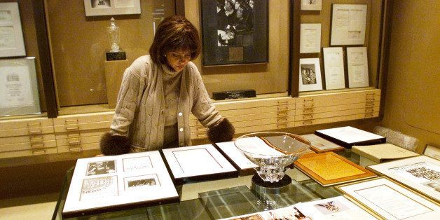 Linda Johnson Rice, president and chief operating officer of Jet magazine, looks over awards and recognitions won by the magazine in its 50-year lifetime Monday, Dec. 10, 2001 at Jet's Chicago headquarters. Johnson is the daughter of Jet founder John. H. Johnson. (AP Photo/Ted S. Warren)