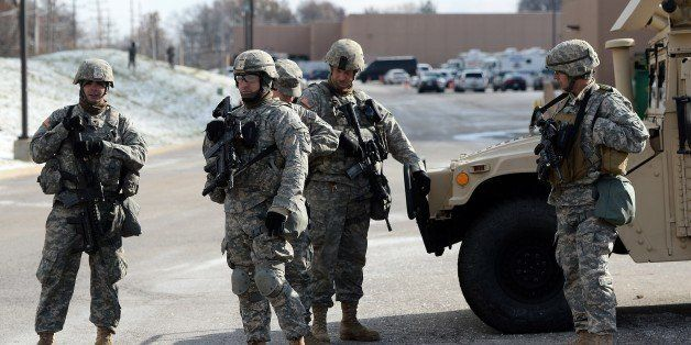 National Guard soldiers secure the police command center set up at a shopping mall in Ferguson, Missouri, on November 27, 201