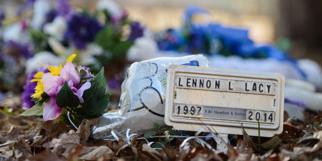 A small metal placard marks the grave of Lennon Lacy Sunday, Dec. 14, 2014, at Old Shaw-Lacy Field Cemetery in Bladenboro, N.