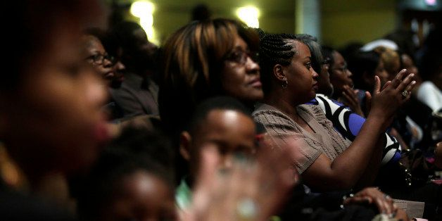 ST. LOUIS MO - NOVEMBER 30 : Worshipers listen as Reverend Al Sharpton speaks about the shooting death of Michael Brown durin