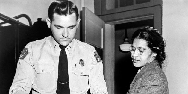 Mrs Rosa Parks, a Negro seamstress, being fingerprinted after her refusal to move to the back of a bus to accommodate a white