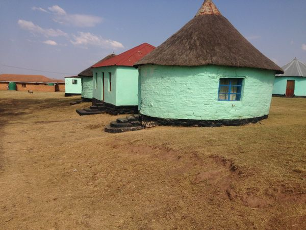 These huts are the homes of Mandela's childhood neighbors in the town of Mqhekezweni. The land is still occupied by South Afr