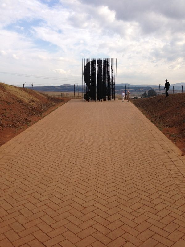 A towering steel sculpture depicting Mandela's profile marks the capture site where the South African leader was taken into c