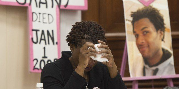 Tressa Sherrod cries after telling the story of her son, 22-year-old John Crawford III who was shot and killed by police in a