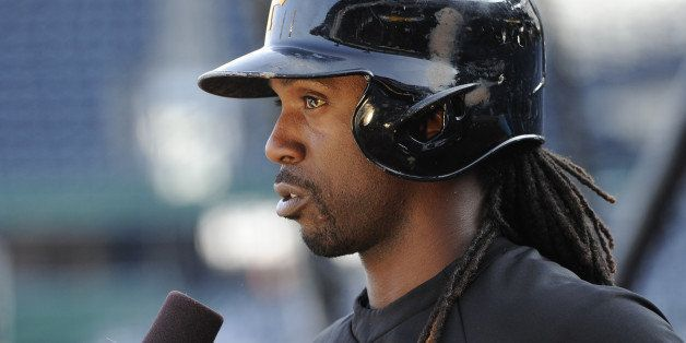 PITTSBURGH, PA - OCTOBER 1:  Andrew McCutchen #22 of the Pittsburgh Pirates talks with ESPN before the National League Wild C