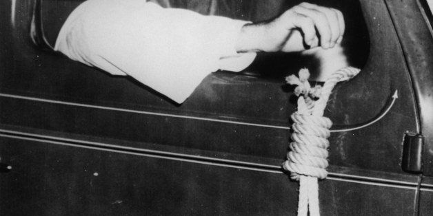 UNSPECIFIED - CIRCA 1939:  Member of the Ku Klux Klan with a noose, 75 cars of the Ku Klux Klan were driving through Miami, F