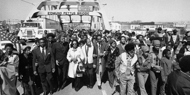 Aided by Father James Robinson, Mrs. Coretta Scott King, widow of Dr. Martin Luther King, Jr., center, and John Lewis of the