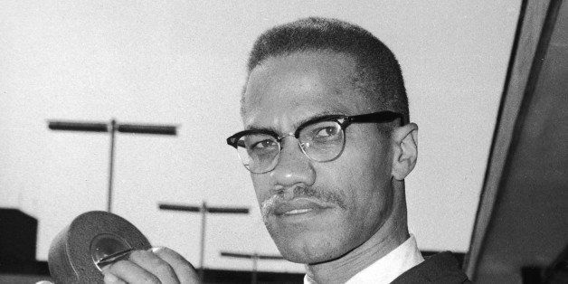 Portrait of American political activist and radical civil rights leader Malcolm X (1925 - 1965) as he holds an 8mm movie came