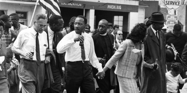 March 1965:  Martin Luther King (1929  - 1968) and his wife Coretta Scott King lead a civil rights march from Selma, Alabama,