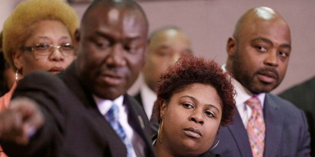 Samaria Rice, center, the mother of Tamir Rice, a 12-year-old boy fatally shot by a Cleveland police officer, watches the vid