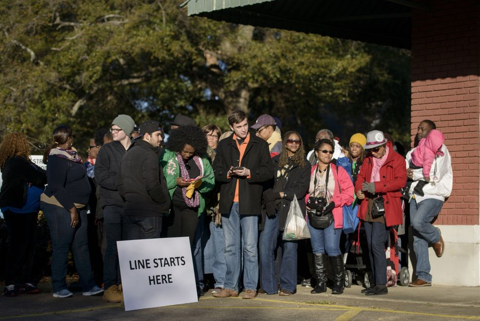 People wait in line to attend an anniversary event at the Edmund Pettus Bridge.