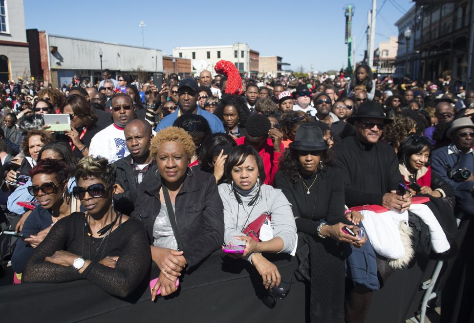 People attend an event marking the 50th Anniversary of the Selma to Montgomery civil rights marches at the Edmund Pettus Brid
