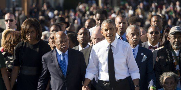 US President Barack Obama walks alongside Amelia Boynton Robinson (R), one of the original marchers, the Reverend Al Sharpton